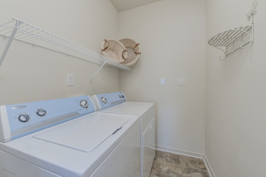 Laundry room with storage space in Indianapolis.
